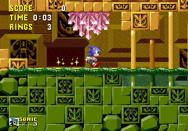 Screenshot of Labyrinth zone 1 in Sonic 1, showing the water in the middle of the screen. The graphics look mostly orange above the water but they become green below it. The top of the water is covered with ripples made with sprites.